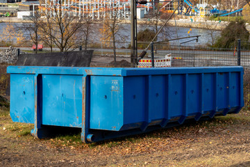 Large blue dumpster container