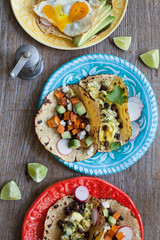vegetarian tacos on colorful plates