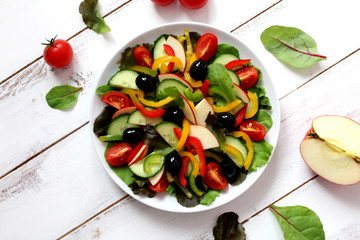 Salad with fresh vegetables. Top view. Healthy food concept.