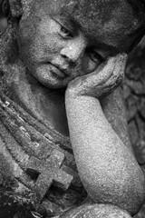 Vintage image of a sad angel  (religion, faith, death, resurrection, eternity concept)