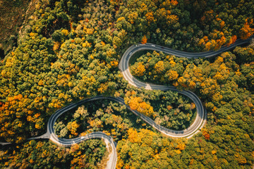 Extreme winding road in sunset light. Aerial view.