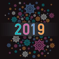 Carte de vœux 2019 de format carré, avec un feu d'artifice de flocons colorés sur un fond noir