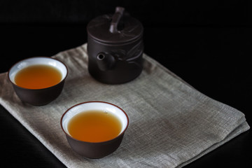 Chinese brown teapot and cups for tea