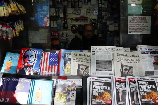 "A news stand outfitted with ""Fake News"" headlines as a stunt pulled off by the Columbia Journalism Review is pictured in the Manhattan borough of New York"