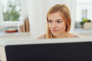 Young businesswoman working on a large monitor