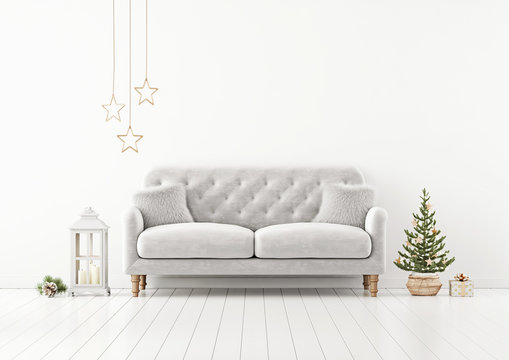 Living room interior wall mock up with grey tufted sofa, fur pillows, lantern and decorated christmas tree on empty white background. 3D rendering.