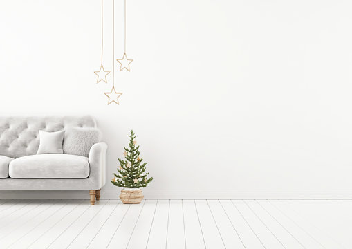Living room interior wall mock up with grey tufted sofa, fur pillow, stars and decorated christmas tree on empty white background. 3D rendering.