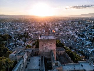 Aerial drone photo above The Alhambra Palace of Granada Spain at sunset.