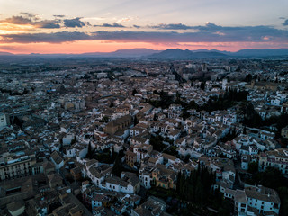 Aerial drone photograph of the city of Granada Spain at sunset