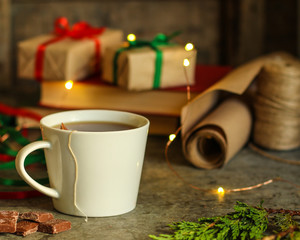 tea in a white cup (tea bag) gifts on the table. holiday atmosphere. top image. food background