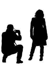 Man with camera and woman on white background