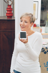 Blond woman holding her mobile chatting