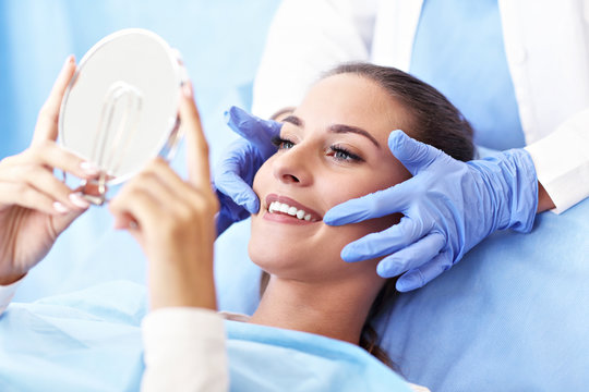 Adult woman having a visit at the dentist's
