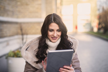 Attractive women looking at tablet.