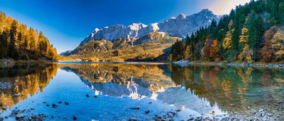 Foto auf Acrylglas Wasserfalle Panorama image of mountains with water reflection in the lake