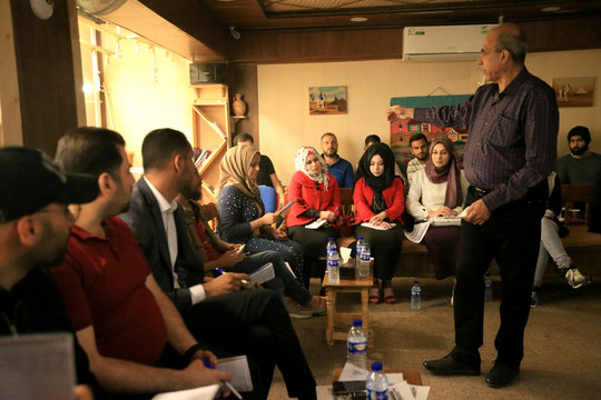 Students of journalism gather at training workshop for Iraqi journalists at Qantara Culture Cafe in Mosul