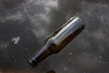 Bottle in dirty water