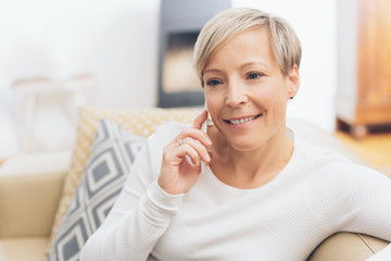 Relaxed mature blond woman with a contented smile