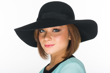 Close up of a Cheerful Pretty Woman in Black Summer Hat