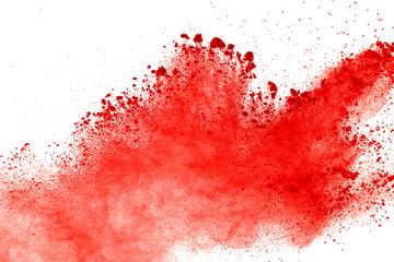 Red powder explosion on white background. Paint Holi.