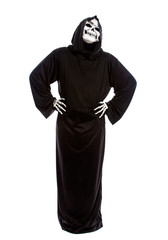 Halloween costume of a skeleton grim reaper wearing a black robe on a white background looking impatient or upset and waiting
