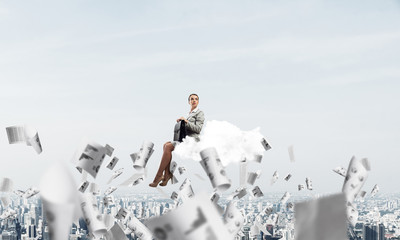 Woman float above city on cloud and papers flying around