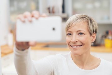 Attractive woman posing for a selfie on her mobile