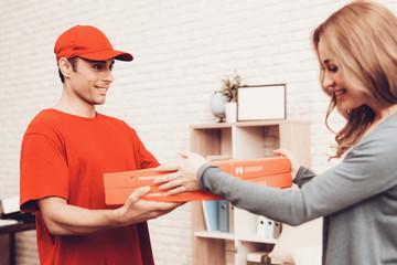 Arab Deliveryman Gives Pizza Box Smiling Girl.