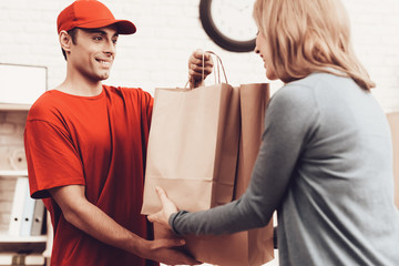 Man Arab Nationality Works in Delivery with Woman.