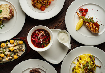 Different types of dishes on the table, top view. Concept for restaurant menu