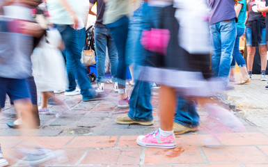 Abstract blurred image of people walking on the street