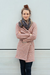 Trendy young woman in scarf and coat