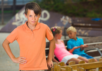 Portrait of boy 9-12 years old which is taking offense on his friends