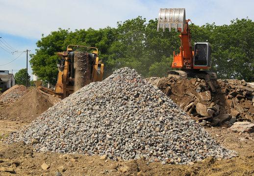Stone crusher and crane in working