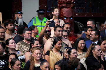 People wait ahead of Britain's Prince Harry and Meghan, the Duchess of Sussex attending a formal powhiri welcoming ceremony and luncheon in Te Papaiouru, Rotorua