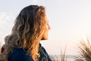Woman relaxed with strong sunlight on face