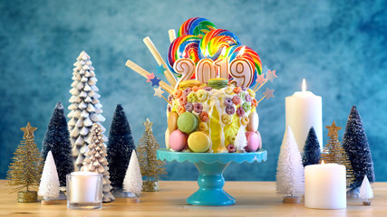2019 Happy New Year's candy land lollipop drip cake in colourful party table setting.