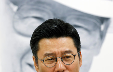 Baek Cheon-ho, a Senior Executive in charge of Hyundai Asan's North Korea business, looks on as Hyundai Group founder Chung Ju-yung's portrait is seen in the background in Seoul