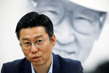 Baek Cheon-ho, a Senior Executive in charge of Hyundai Asan's North Korea business, speaks as Hyundai Group founder Chung Ju-yung's portrait is seen in the background in Seoul