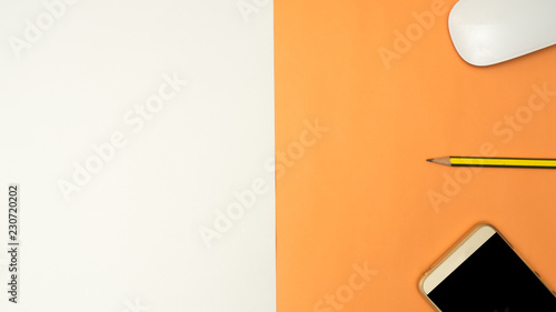 Wall mural smartphone,pencil  on white and orange background business concept