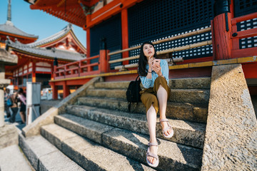 traveler sitting on stairs after visited temple