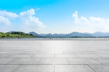 Empty square floor and green mountain scenery