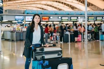 asian woman walking through airport counter