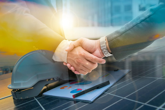 Businessmen are shaking hands for business venture and Marketing on energy.