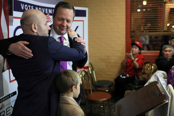 Virginia Republican candidate for U.S. Senate Corey Stewart hugs Raiklin while speaking to voters at a campaign event at a pizza parlor in Annandale