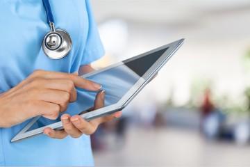 Doctor using digital tablet.