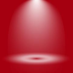 Fondo rojo con reflector sobre suelo iluminado