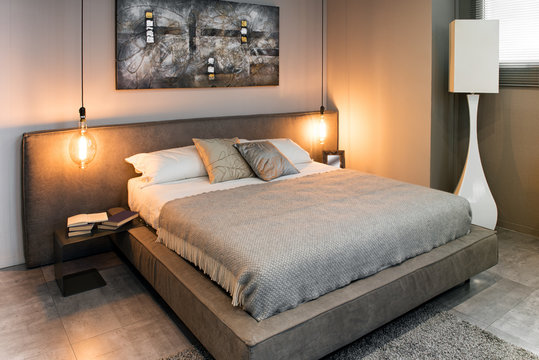 View of double bed in cozy interior