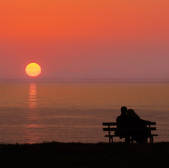 Silhouette of man and woman, Couples hugging, Sunset in autumn