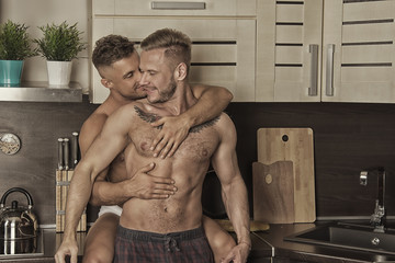 Two attractive guys in the kitchen.